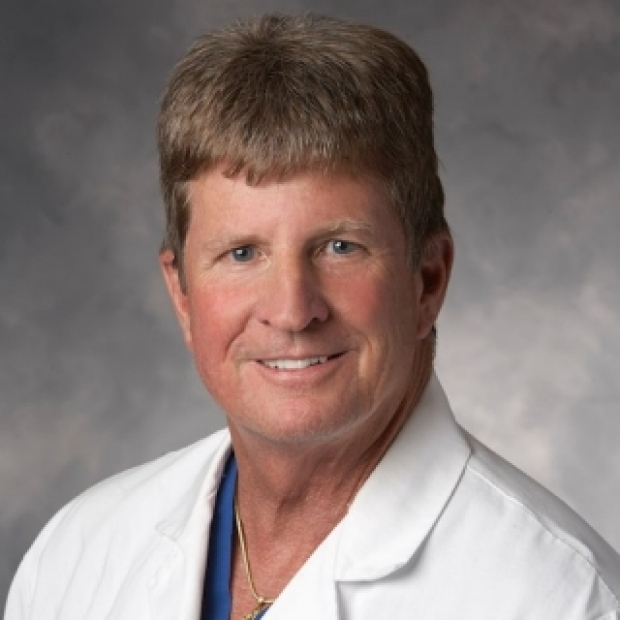 Dr. E. John Harris